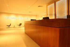 Wood Veneer Paneled Reception Desk - Orchard Brae House - Colinton Furniture